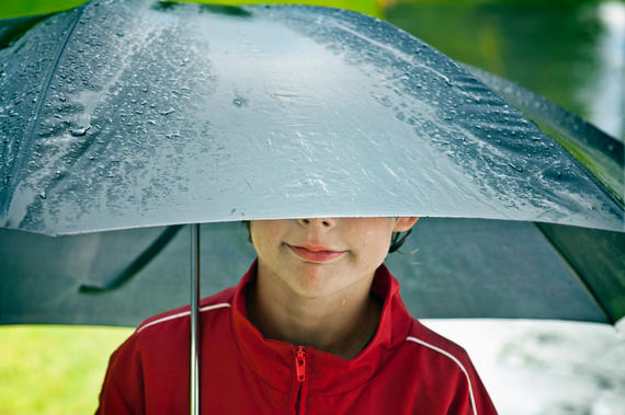 Present Perfect Tense - Boy under an umbrella