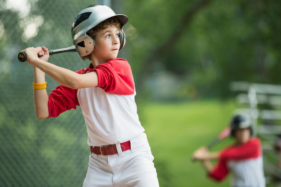 Twelve year old male batter waiting for pitch