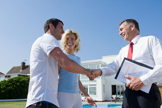 Couple and estate agent