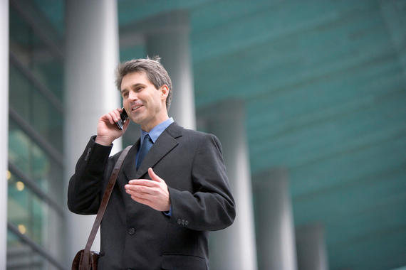 Future Perfect Tense - Businessman in Front of Office Building Using Cell Phone